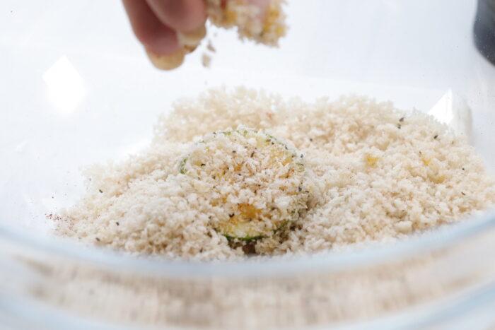 air fryer zucchini chip dredged in dry ingredients