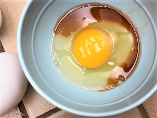 Eggs and vanilla extract in a bowl for chocolate chip cookies